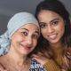 Portrait of a woman with cancer embracing adult daughter
